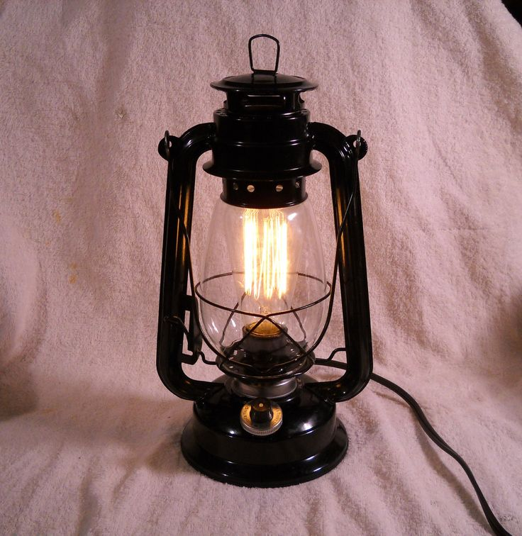 Black Electric lantern industrial table lamp hanging lighting with edison marconi filament bulb squirrel cage men's gift. $69.95, via Etsy.