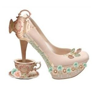 Alice in Wonderland Tea Party Shoes - not *ugly* per se, but pretty ridiculous! Can't even imagine walking with that cup clattering along on the bottom of the heel...
