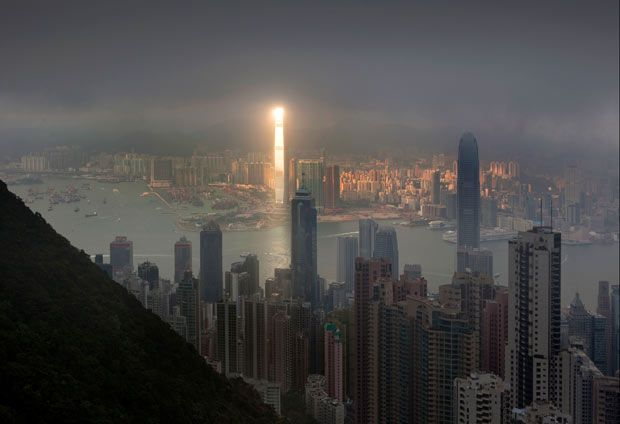 A bright beam of sunlight illuminates one of the tallest buildings in the world - the 1,588ft tall, 108-floor International Commerce Centre in Hong Kong - while leaving the rest of the cityscape in cloudy darkness. The moment was captured by keen Russian photographer Pavel Kiselev.