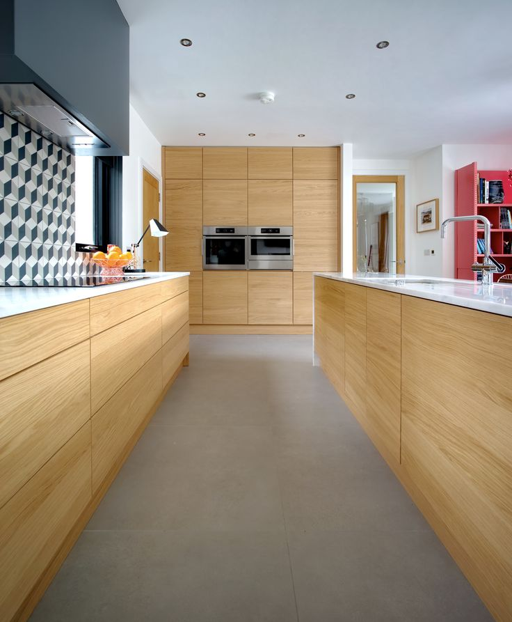 Modern handleless doors and drawers are push opening. Slim Composite work Surfaces add a beautiful contrast.