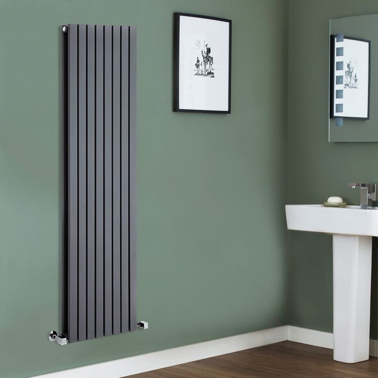 We love this grey radiator against the green background.