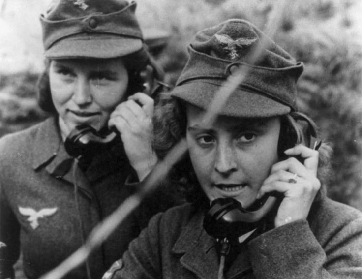 WWII-Two women of the German anti-aircraft gun auxiliary operating field telephones during World War II.