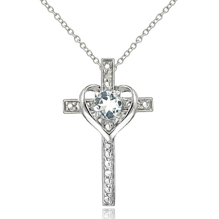 This beautiful necklace features a glistening aquamarine stone that is set regally in a heart in the center of an inspiring cross design. This pendant is crafted of sterling silver and shimmers with a