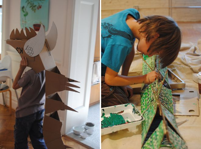 Kid made cardboard dragon costume from Eclectic Mom