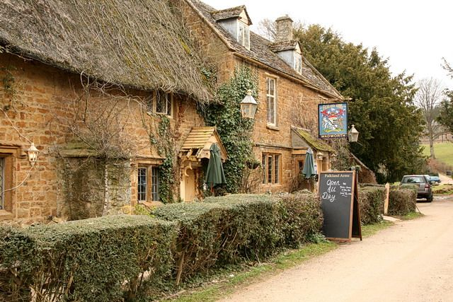 The 16th century Falkland Arms, Great Tew, Gloucestershire, England