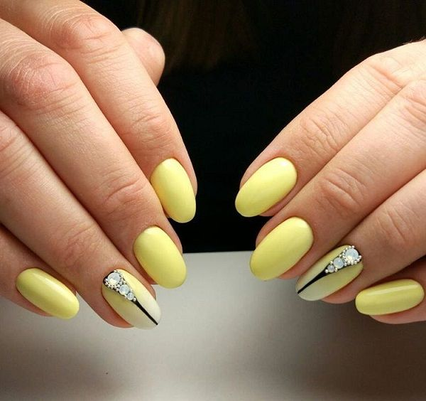 Yellow and Black Diamond Nails. Get your yellow nails coupled with the black strips and rhinestones, so that they can go with your fancy yellow evening outfit.