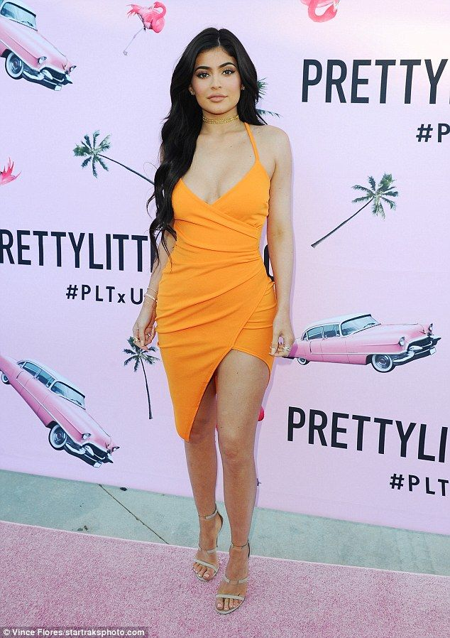 All eyes on her: Kylie made a bold statement in a tangerine frock at the US launch for clothing retailer PrettyLittleThing