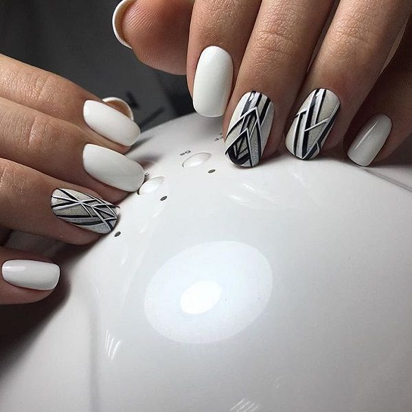 Grace-y Black and Silver Geometric Nail Art Design. This royal black and white geometric nail art design is simply worth trying. The addition of glitter is a plus for this art.