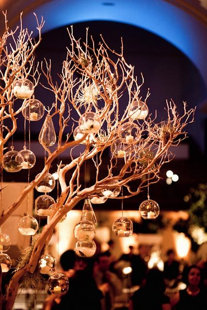 hanging candles from birchwood tree - natural or gold sprayed.... candles to hang in bubble vase with a floral head here and there in each bubble.