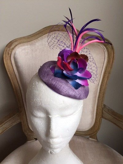 A personal favourite from my Etsy shop https://www.etsy.com/au/listing/470640096/purple-fascinator-with-multi-coloured
