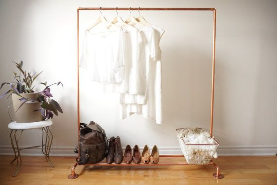 This distinctive copper clothing rack will complement your home, shop, or studio. Most clothing racks exist to be forgotten beneath the clothes that they carry; this clothing rack wants to be seen. The lustre of the copper and the minimalist design work together to create a modern, elegant, exciting piece of furniture. Baskets, boxes, and other items can be placed along the bottom bars for extra storage or the bottom can be left open to highlight the airy, open, construction. Each garment…