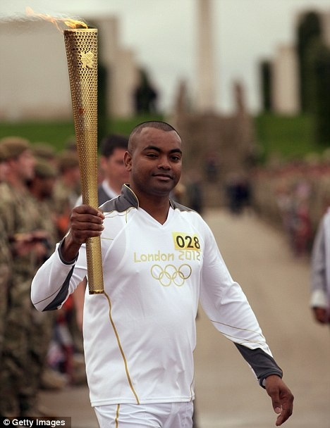 Grenadan-born Johnson Beharry, who was awarded the Victoria Cross, carries the Olympic torch today. His Princess of Wales Royal Regiment is one of those likely to be cut