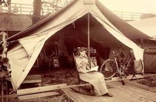 WhatWasThere | Explore Photos:Annie Oakley Outside Her Tent at World's Fair DESCRIPTION Annie Oakley (August 13, 1860 – November 3, 1926), born Phoebe Ann Moses, was an American sharpshooter and exhibition shooter. Oakley's amazing talent and timely rise to fame led to a starring role in Buffalo Bill's Wild West show, which propelled her to become the first American female superstar.
