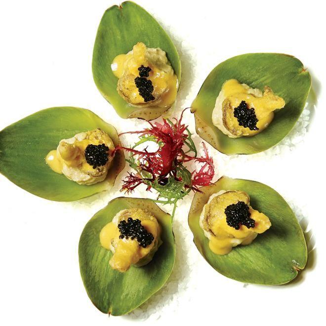 "Artichoke ""oysters"" with crispy oyster mushrooms, artichoke puree, kelp ""caviar,"" and yellow tomato béarnaise."