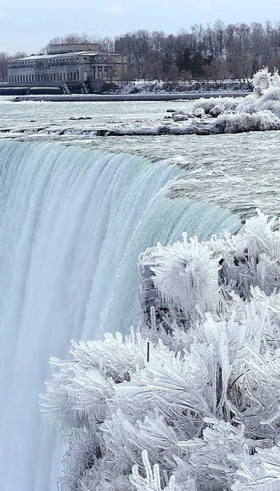 Frozen Niagara Falls In Winter. When i went there (in the summer) I could feel it's mists from blocks away and itsounded like a low constant roar