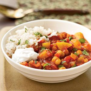 Moroccan Chickpea Stew - This is so flavorful!  You can make the recipe as is but I like to add chicken to it.  I've had this over couscous but rice is perfect as well.  This heats up really well the next day too!  Yum!