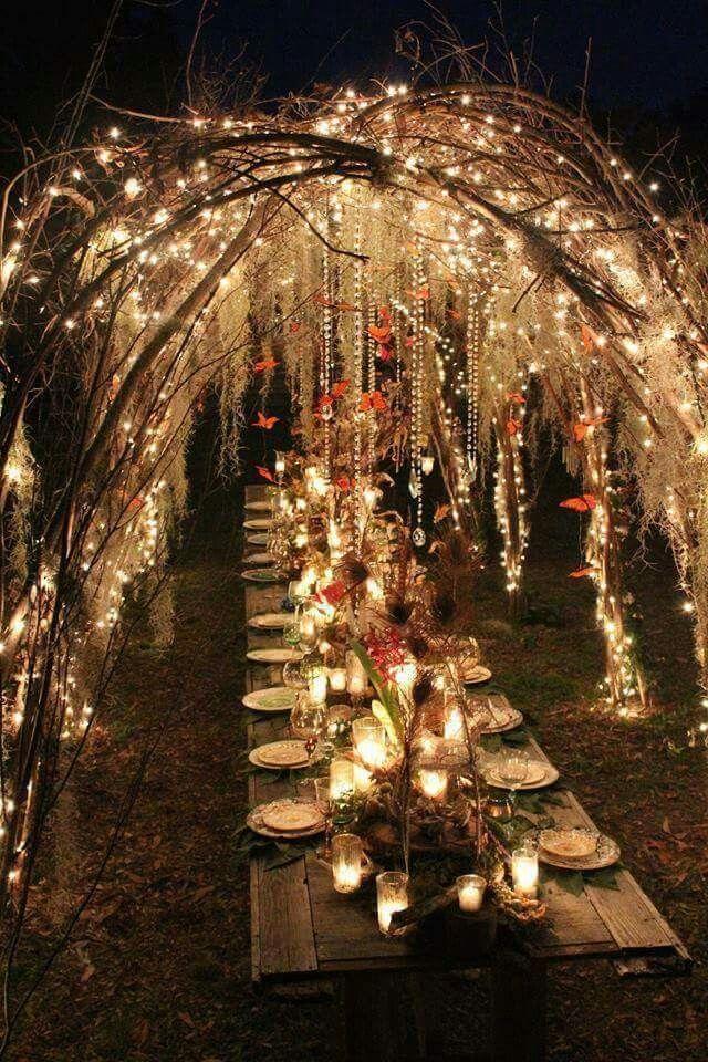 Amazing outdoor wedding setting with lighting over rectangular picnic