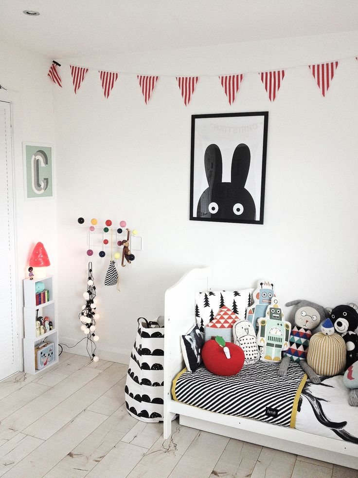 black and white kids room with pops of colour