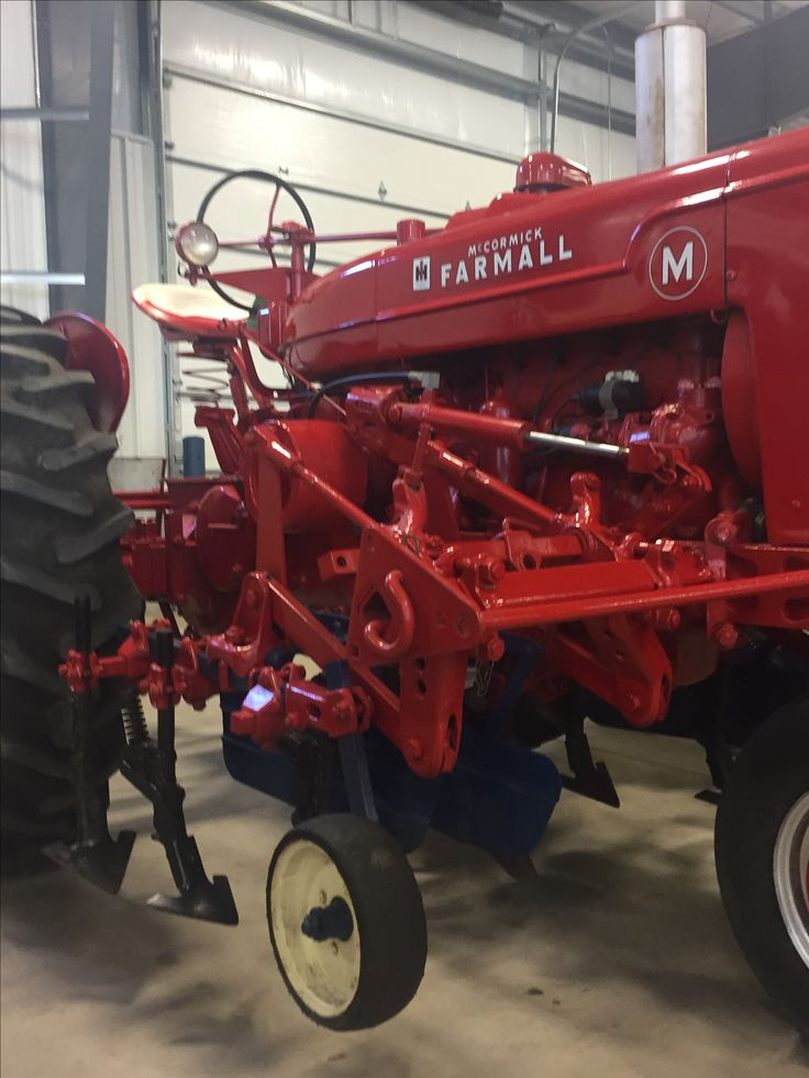 Excellent Farmall M with cultivator.