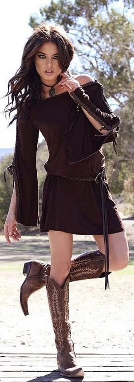 Brown slit-sleeve mini dress with braided leather ties and cowboy boots