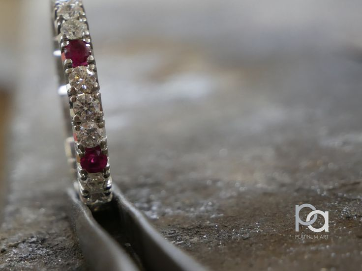 Beautiful Partial Eternity Ring, set with Rubies and Diamonds. A must have for anyone looking to make a statement.