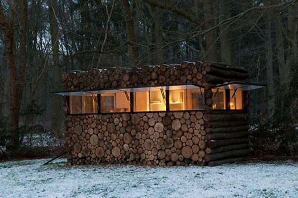 New take on a log cabin. Fully disguised as a stack of wood when the (panoramic) windows are closed.