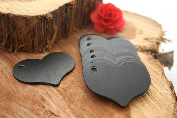 @Jennifer Milsaps L rodriguez. If there is any black in color scheme, these would be so cute! Chalk board gift tags! Reusable!   This is so clever.  These little wood cutouts are cheap at Michaels, and a little chalkboard paint goes a long way