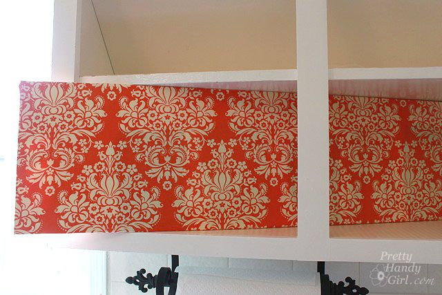fabric covered foam board for back of cabinets.  Makes it easier to switch out when you want a change.