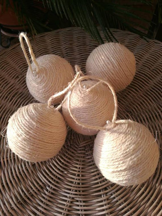 A beautiful handmade Christmas ornament for your tree in recycled jute rope. This ornament was crafted using off white or red jute rope on a styrofoam ball for a rustic look. These balls can be crafted without a hanger so you could use them as bowl fillers all year round. Size: 8