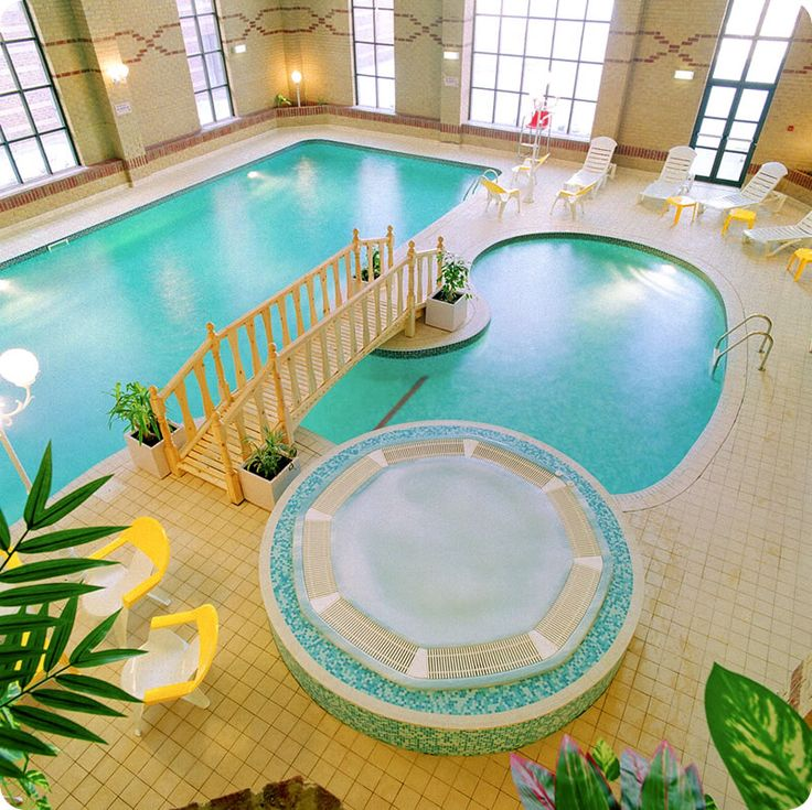 Creative Indoor Pools Design In Luxurious HotelFree Form Pool With Classic Bridge White