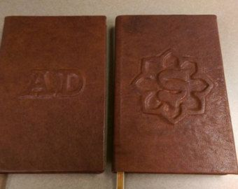 IDEA: leather bound Standford antimicrobial guide   Two custom leather notebooks with raised emboss details