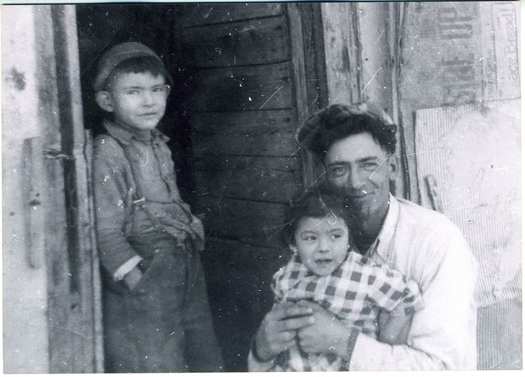 Louise's brother, Peter Ivan leaning against the door, her father Adolphus Half holding me.