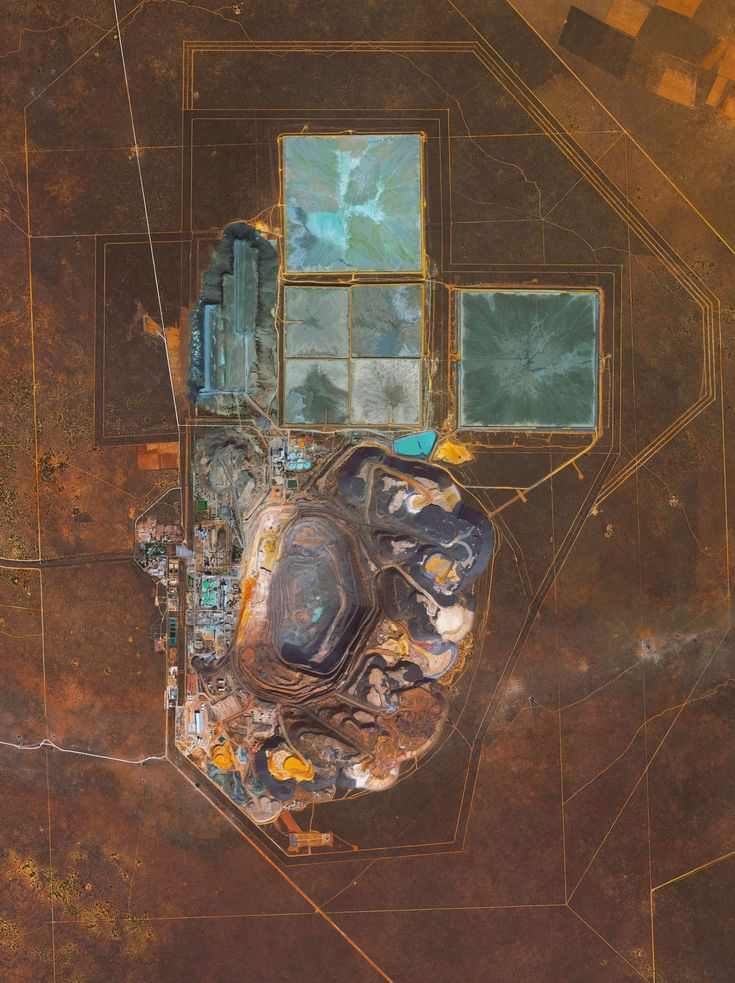 1/10/2016 Jwaneng Diamond Mine Kalahari Desert, Botswana 24°31′23″S 24°42′07″E   The Jwaneng Diamond Mine in Botswana is the richest diamond mine in the world with an annual output of as much as 15.6 million carats (2006). Mine richness takes into account the rate of diamond extraction combined with quality of the diamonds that are mined (sale price per weight). To extract the diamonds, the facility produces 9.3 million tons of ore and an additional 37 million tons of waste rock per year.