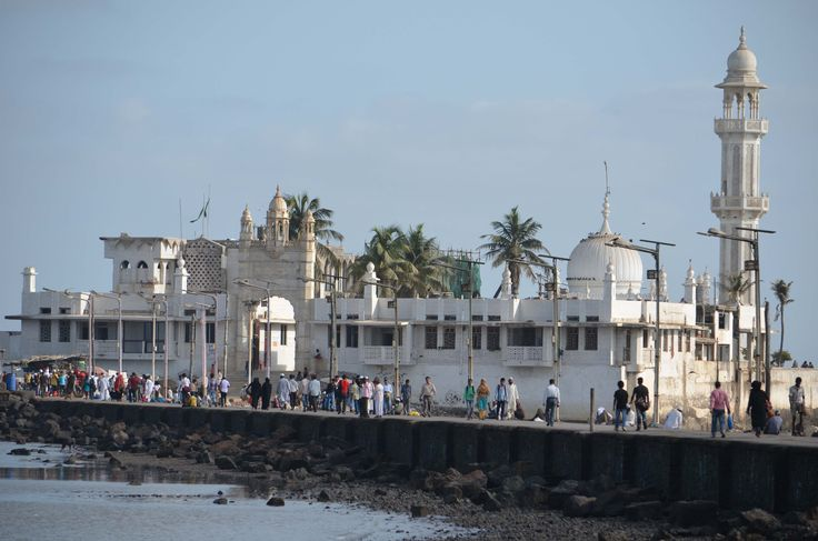 Haji Ali in Mumbai, Mahārāshtra. Haji Ali Dargah (1431) is a mosque and tomb in a secluded location separated from the mainland during high tides.