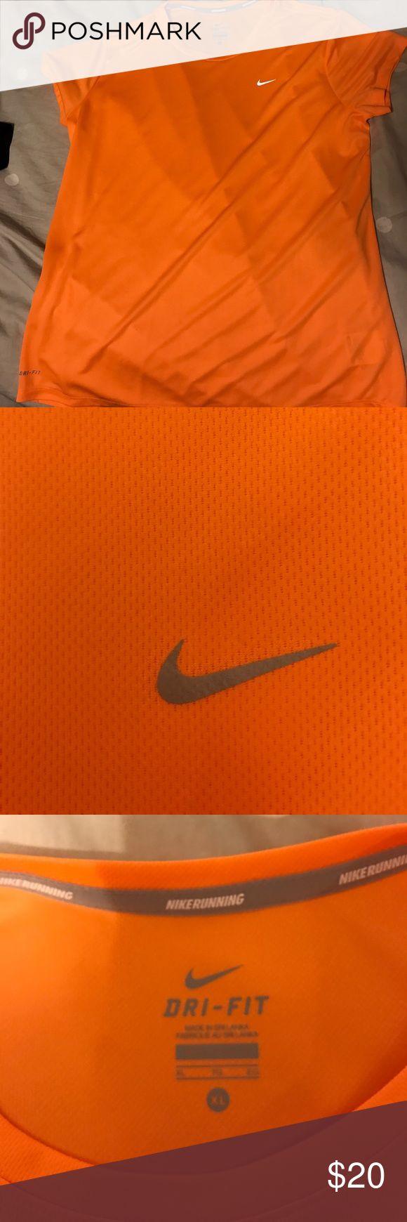 bright orange nike running dri-fit shirt! bright orange nike dri-fit running shirt, size x-large. never worn! in perfect condition. Nike Tops Tees - Short Sleeve