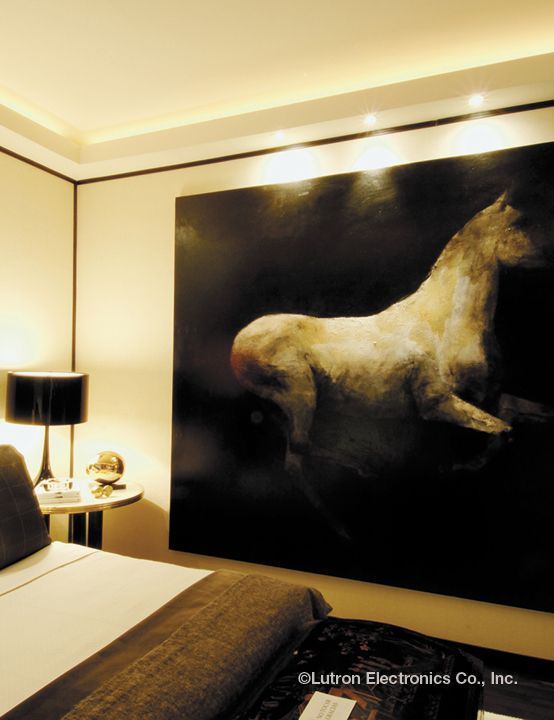 Recessed Lighting Creates A Soft Glow Around This Beautiful Wall Art  Creating A Welcoming Bedroom Atmosphere
