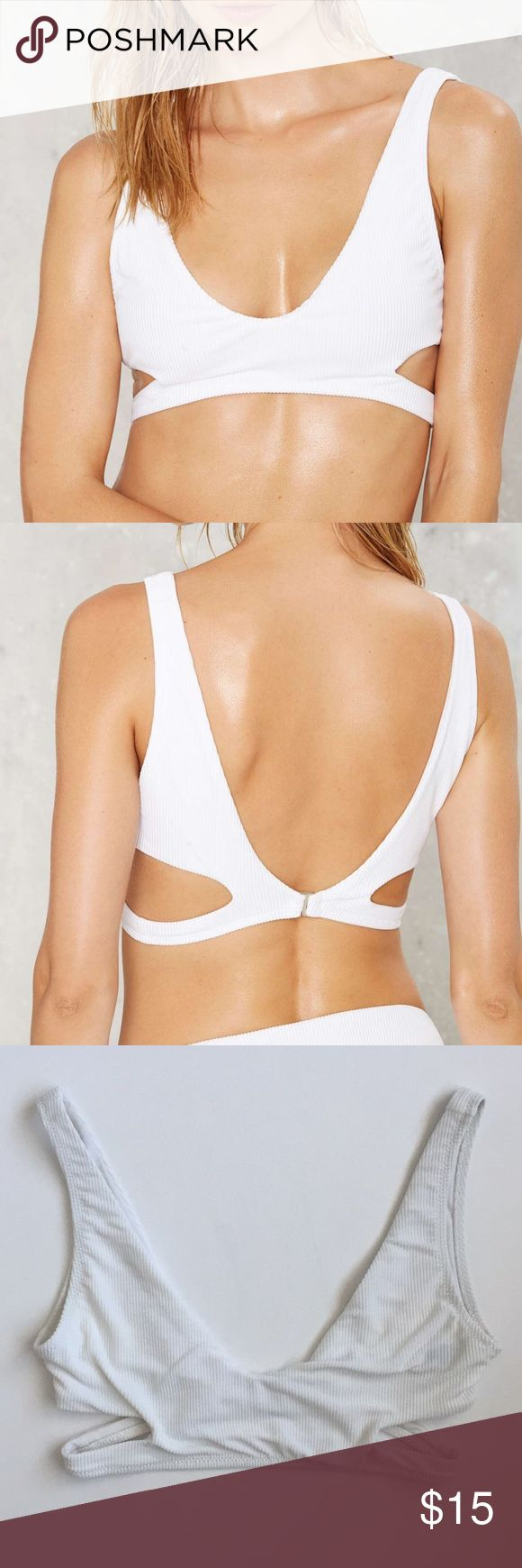 White Alina ribbed cutout bikini top by Nasty Gal White bikini top with cut out features. Hooks in the back with silver hardware   ❗️has some pulling of the fabric. Looks like Velcro got stuck to it almost. Some darker discoloration and imperfections on it❗️  NWT  By Nasty Gal Size XL Nasty Gal Swim Bikinis