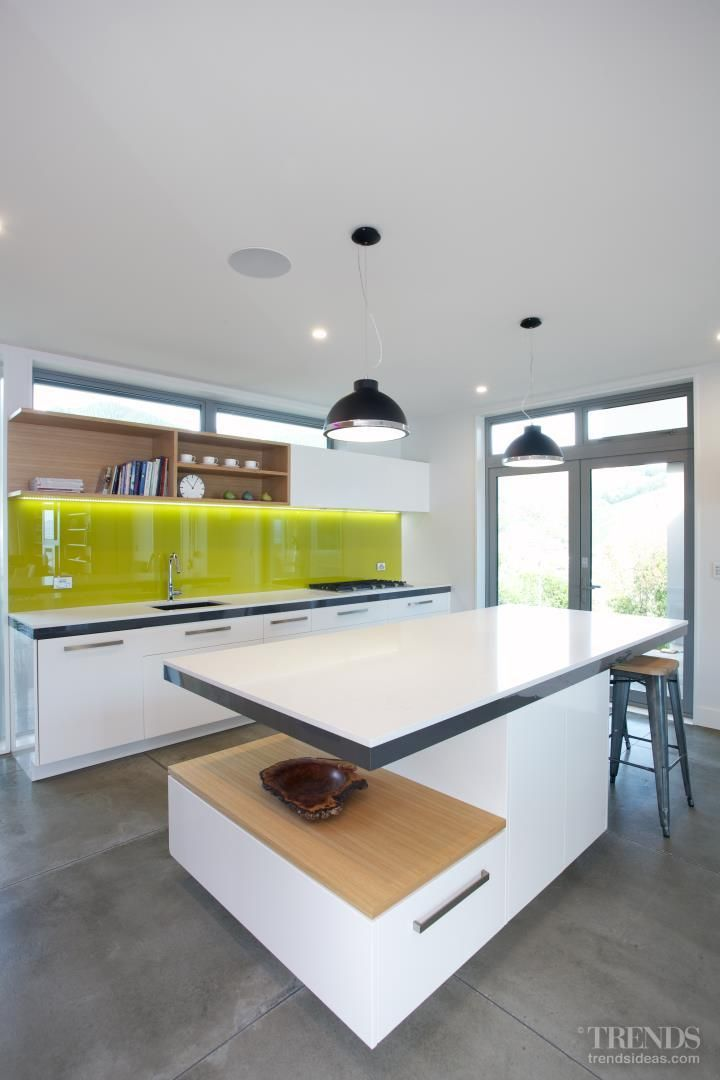 A backpainted glass splashback provides a vibrant accent.