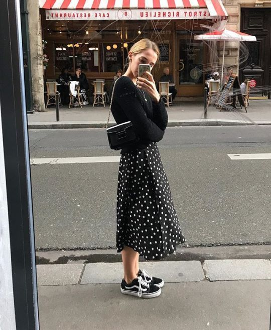 Black and white is always in. Polka dots add a playful and feminine touch to an otherwise edgy and somewhat boyish look.