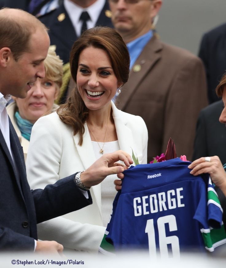 Catherine, Duchess of Cambridge and Prince William Duke of Cambridge is presented with personalised sports shirts for Prince George and Princess Charlotte by BC Governor Christy Clark at Cridge Centre for the Family on the final day of their Royal Tour of Canada on October 1, 2016 in Victoria, Canada.