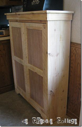 Stand alone pantry with doors, great for window area.