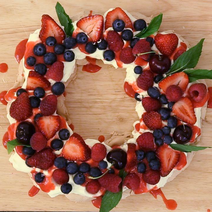 Berry Christmas Pavlova Wreath What you need: For Pavlova Mixture Egg Whites - 5 Caster Sugar - 1 Cup Cornflour - 1 tbsp Vanilla Essence - 1 tbsp Pavlova Toppings Cream - 300g Blueberries - 1 punnet (125g) Strawberries - 2 punnet (500g) Raspberries - 1 punnet (125g) Cherries - 8 Mint - 8 leaves