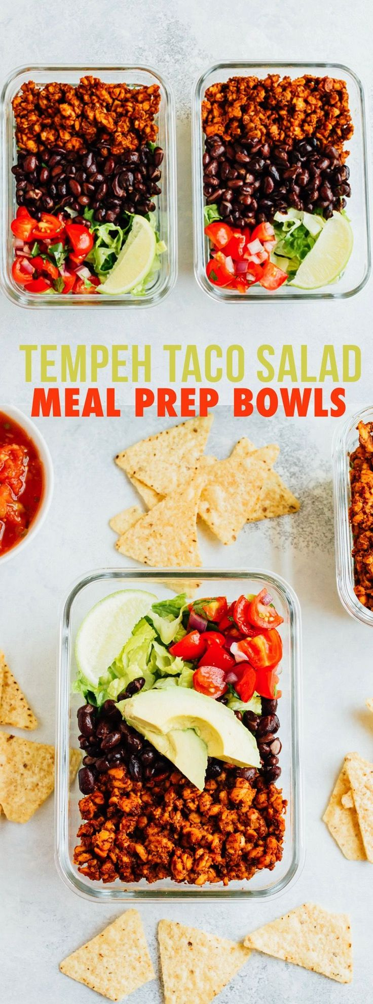 Tempeh Taco Salad Meal Prep Bowls with tempeh taco meat, black beans, tomatoes, onions and avocado