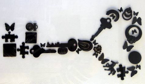 Wall art made from keys and found objects