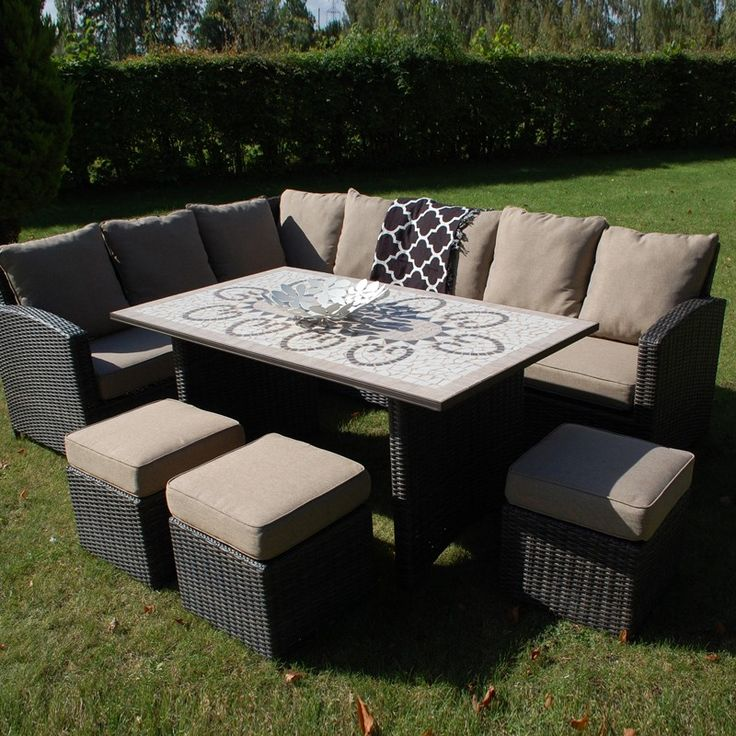 Savannah Modular Dining Set. Large garden dining table, outdoor sofa and footstools.