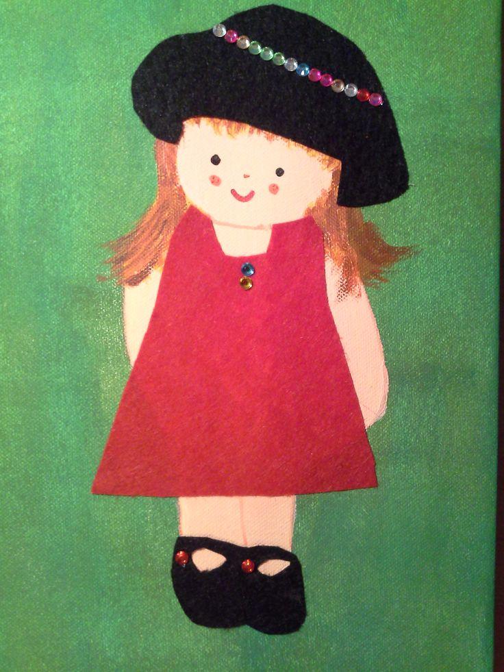 Niña con vestido rojo y sombrero negro