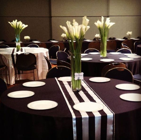 White calla lily centerpieces at an elegant black & white reception! Centerpieces by Michell Events.