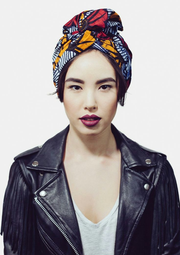 African print turban / black leather biker jacket with fringes. Headwrap outfit inspiration