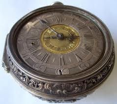 Old Man's pocket watch, it's imbued with magic that allows him to summon the portern and activate it's doorway. Heavily engraved, ancient, shifting lines of text laid aroudn the edges. Incription should be something to do with Magic, TIme, HUmanity and Danger.
