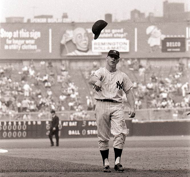 mickey mantle tosses his batting helmet toward the dugout after making the final out of an